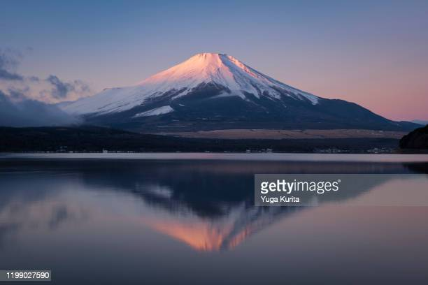 mt. fuji reflected in lake yamanaka at sunrise - new year's day stock pictures, royalty-free photos & images