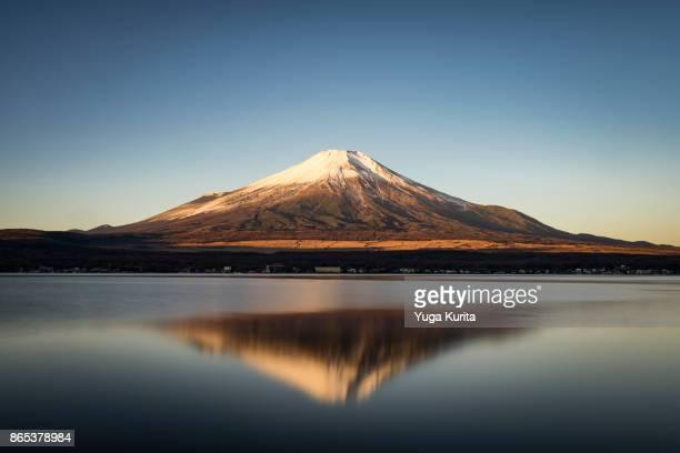 mt. fuji reflected in lake yamanaka - mt fuji stock photos and pictures