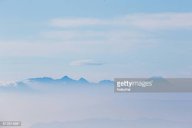 mt. fuji seen from mt. shiroumadake - stratovolcano stock photos and pictures