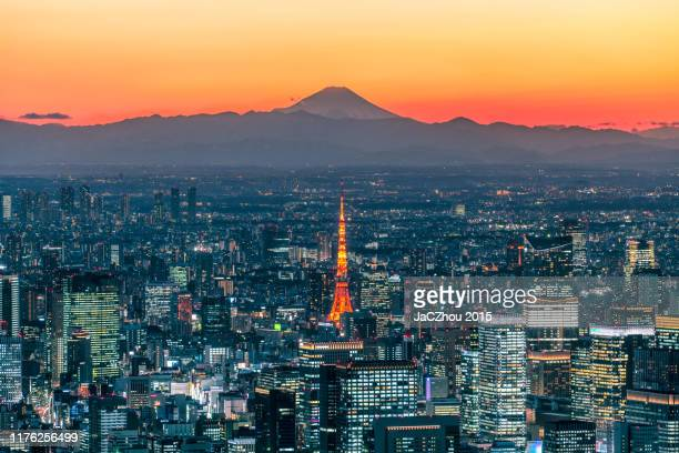 mt. fuji silhouette and tokyo skyline - tokyo japan stock pictures, royalty-free photos & images