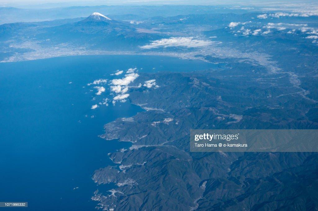 Mt. Fuji, Suruga Bay and Izu Peninsula in Shizuoka prefecture in Japan daytime aerial view from airplane : Stock Photo