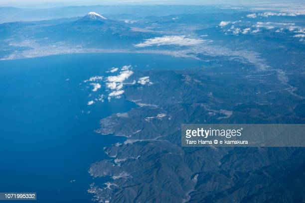 mt. fuji, suruga bay and izu peninsula in shizuoka prefecture in japan daytime aerial view from airplane - mishima city stock photos and pictures