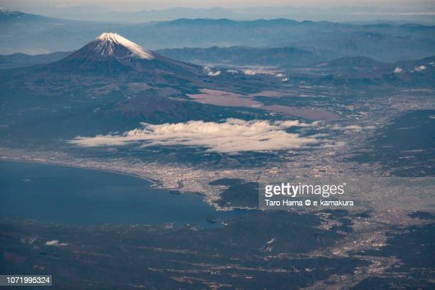 mt. fuji, suruga bay, and numazu and mishima cities in shizuoka prefecture in japan daytime aerial view from airplane - mishima city stock photos and pictures
