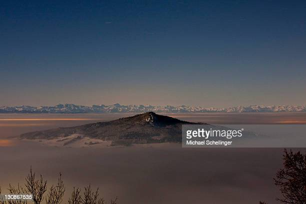 Mt Hohestoffel at full moon, towering out of a sea of clouds, Constance County, Baden-Wuerttemberg, Germany, Europe