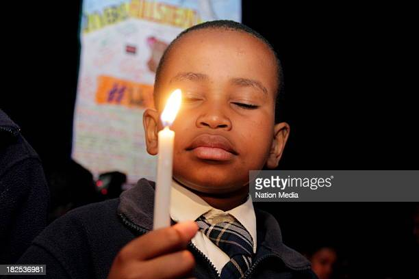 Mt Kenya Academy's Brian Wamahiu during prayers and tributes for the Westgate Terror attack victims on September 27 2013 outside Raybells restaurant...
