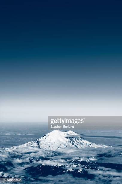mt. rainier aerial view with deep blue sky - dark blue stock pictures, royalty-free photos & images