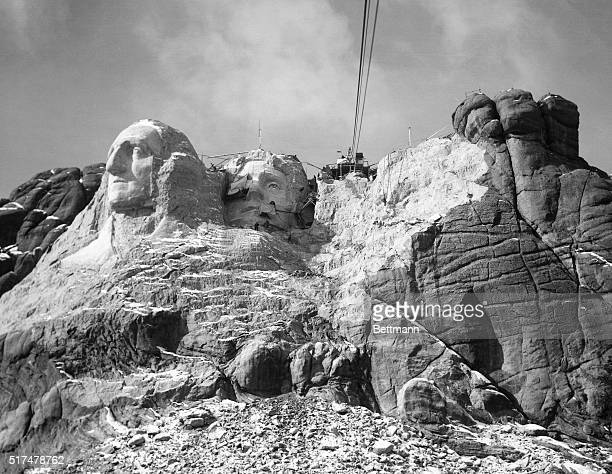 The Head of Washington Jefferson and the beginning of Lincoln as seen from the cable Nearly five hundred thousand tons of granite have been removed...