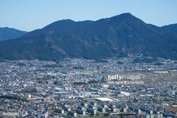 Mt. Takejo in Shime and Sue towns in Fukuoka prefecture in Japan daytime aerial view from airplane