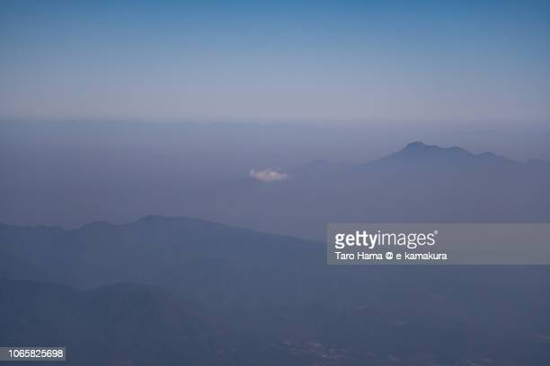 Mt. Tara and Mt. Unzen in Nagasaki prefecture in Japan daytime aerial view from airplane