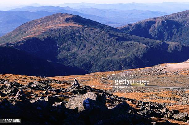 Mt Washing Cog Railway Train travels through the landscape of White Mountains National Park.