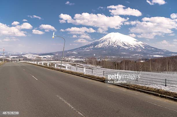 Mt Yotei surrounded by fluffy spring clouds
