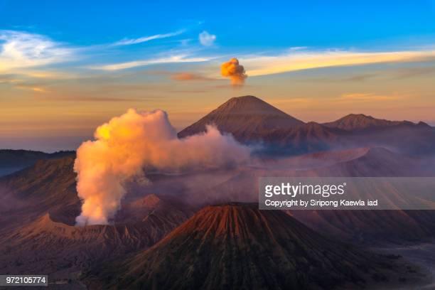 mt.bromo and mt.semeru eruption during sunrise at the bromo-tengger-semeru national park, east java, indonesia. - mt semeru stock pictures, royalty-free photos & images