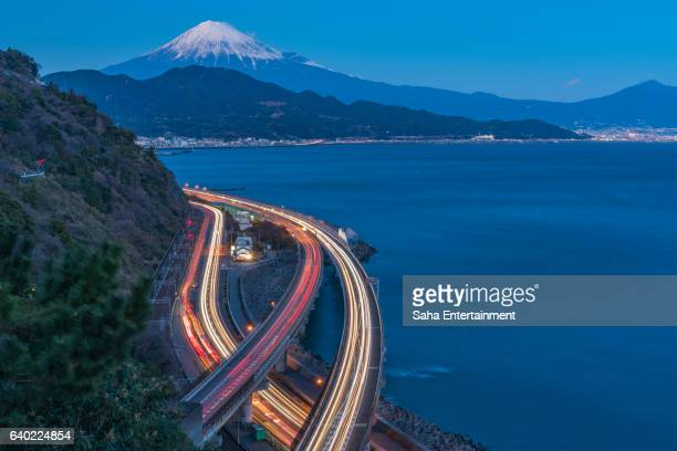 mt.fuji and car rush at dusk - saha entertainment stock pictures, royalty-free photos & images