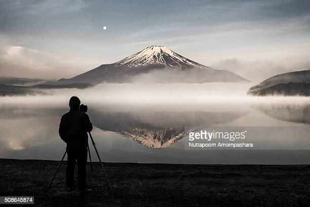 Mt.fuji and its reflection with a cameraman