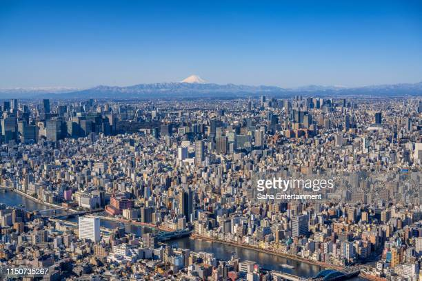 mt'fuji and tokyo buildings - saha entertainment stock pictures, royalty-free photos & images