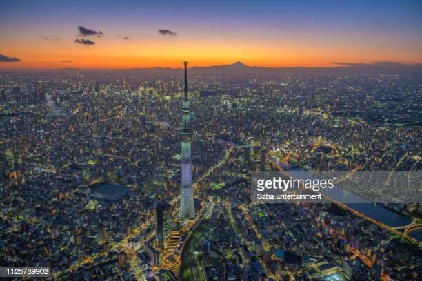 mt'fuji and tokyo sky tree light up aerial at dusk - saha entertainment stock pictures, royalty-free photos & images