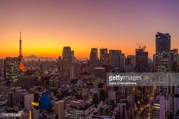 mt'fuji and tokyo tower light up at dusk,minato-ku,tokyo,japan - saha entertainment stock pictures, royalty-free photos & images