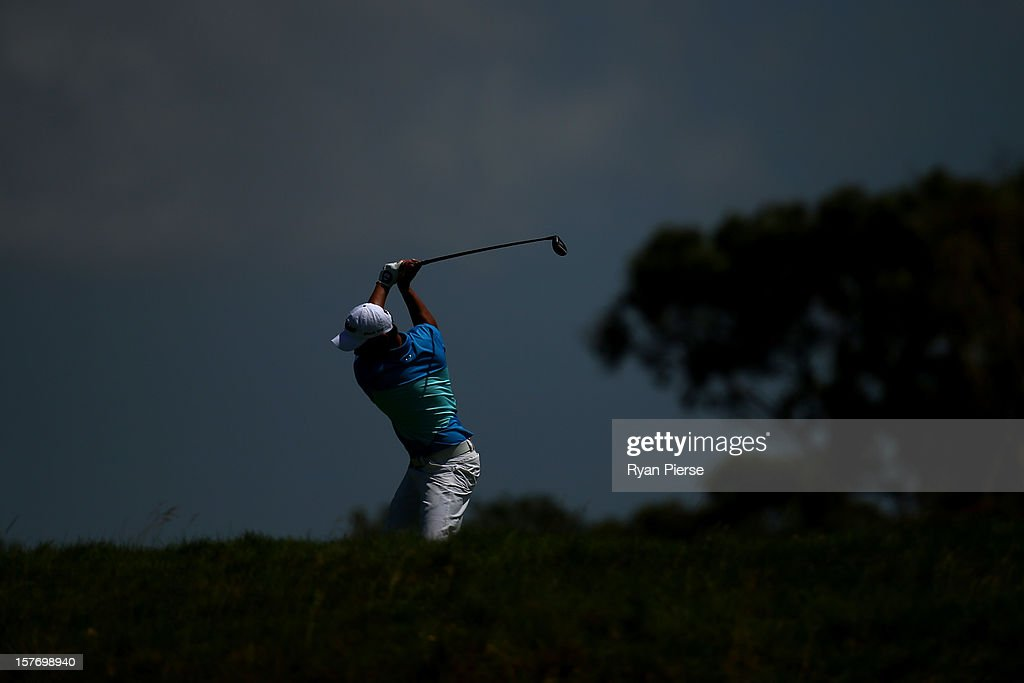 Mu Hu of China plays a shot on the fairway during round one of the 2012 Australian Open at The Lakes Golf Club on December 6, 2012 in Sydney, Australia.