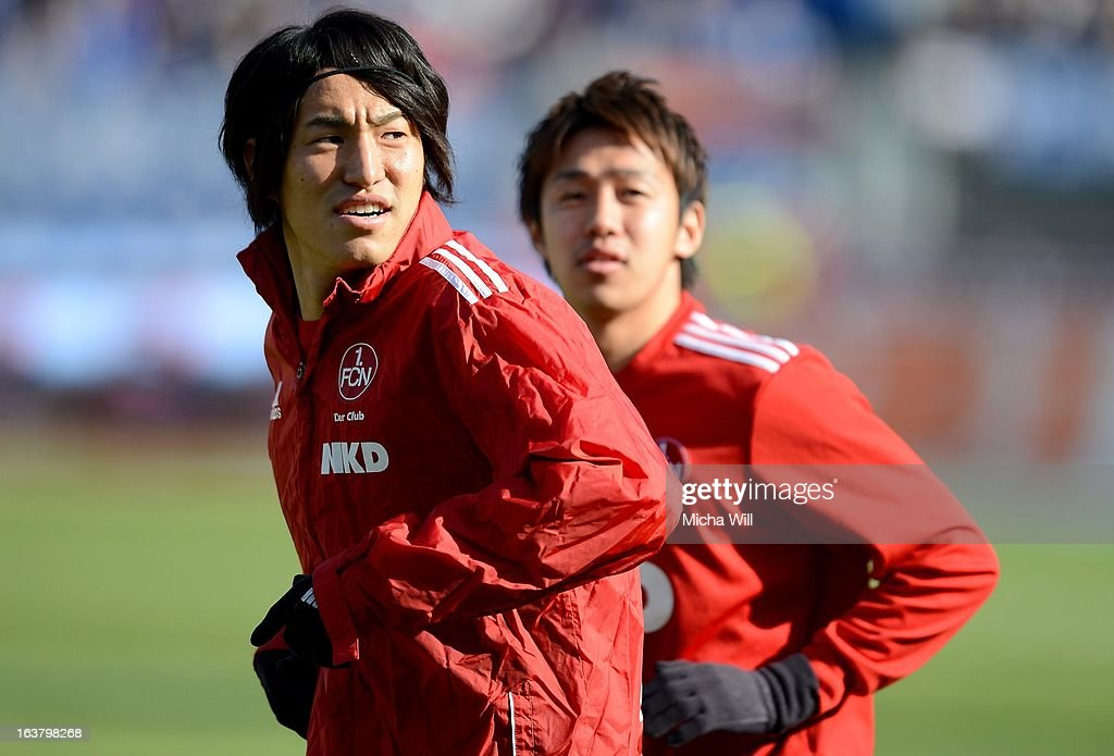 Mu Kanazaki (L) and Hiroshi Kiyotake of Nuernberg warm up prior to the Bundesliga match between 1. FC Nuernberg and FC Schalke 04 at Grundig-Stadion on March 16, 2013 in Nuremberg, Germany.