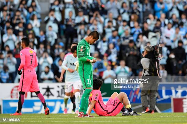 Mu Kanazaki and Hitoshi Sogahata of Kashima Antlers show dejection after the scoreless draw and missing the title in the J.League J1 match between...