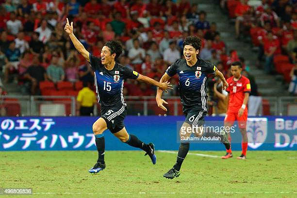 Mu Kanazaki of Japan celebrates after scoring the first goal during the 2018 FIFA World Cup Qualifier match between Singapore and Japan at National...