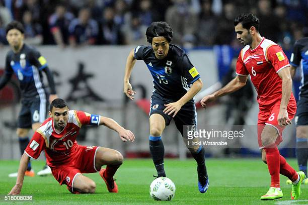 Mu Kanazaki of Japan in action during the FIFA World Cup Russia Asian Qualifier second round match between Japan and Syria at the Saitama Stadium on...