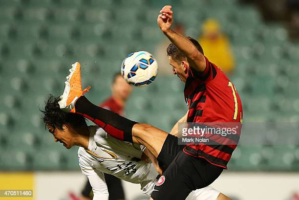 Mu Kanazaki of Kashima and Matthew Spiranovic of the Wanderers contest possession during the Asian Champions League match between the Western Sydney...