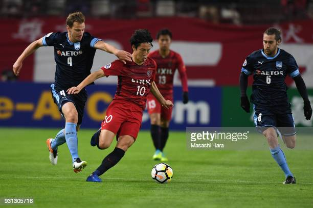 Mu Kanazaki of Kashima Antlers and Alex Wilkinson of Sydney FC compete for the ball during the AFC Champions League Group H match between Kashima...