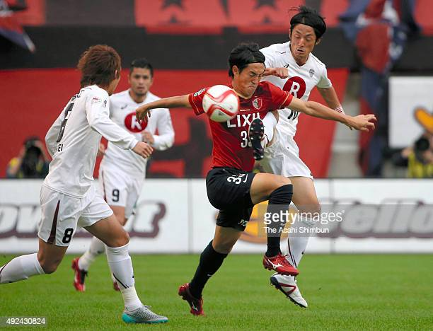 Mu Kanazaki of Kashima Antlers and Ryota Morioka of Vissel Kobe compete for the ball during the JLeague Yamazaki Nabisco Cup semi final second leg...