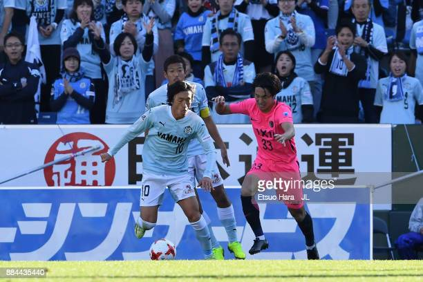Mu Kanazaki of Kashima Antlers and Shunsuke Nakamura of Jubilo Iwata compete for the ball during the JLeague J1 match between Jubilo Iwata and...