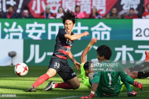 Mu Kanazaki of Kashima Antlers and Shusaku Nishikawa of Urawa Red Diamonds compete for the ball during the JLeague J1 match between Kashima Antlers...