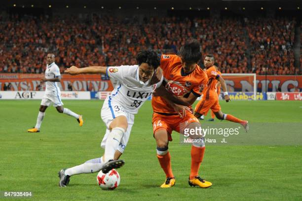 Mu Kanazaki of Kashima Antlers and Teruki Hara of Albirex Niigata compete for the ball during the JLeague J1 match between Albirex Niigata and...