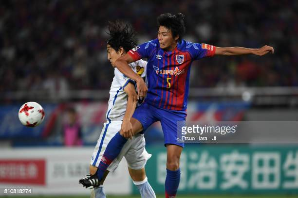 Mu Kanazaki of Kashima Antlers and Yuichi Maruyama of FC Tokyo compete for the ball during the J.League J1 match between FC Tokyo and Kashima Antlers...