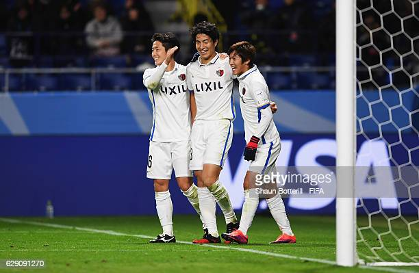 Mu Kanazaki of Kashima Antlers celebrates scoring his team's second goal with team mates during the FIFA Club World Cup second round match between...