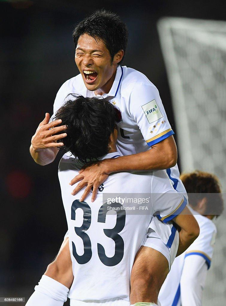 Mu Kanazaki of Kashima Antlers (33) celebrates with Shuhei Akasaki as he scores their second goal during the FIFA Club World Cup Play-off for Quarter Final match between Kashima Antlers and Auckland City at International Stadium Yokohama on December 8, 2016 in Yokohama, Japan.