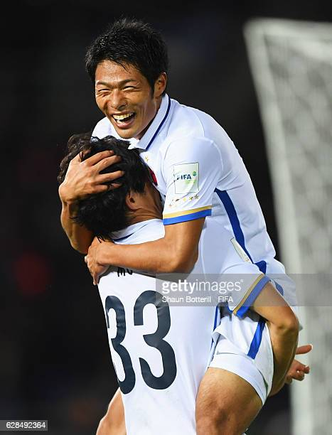 Mu Kanazaki of Kashima Antlers celebrates with Shuhei Akasaki as he scores their second goal during the FIFA Club World Cup Play-off for Quarter...