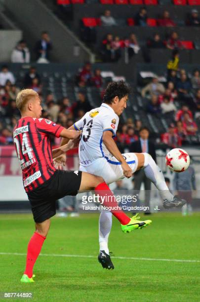 Mu Kanazaki of Kashima Antlers controls the ball under pressure of Akito Fukumori of Consadole Sapporo during the JLeague J1 match between Consadole...