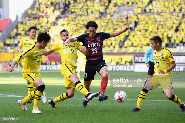 Mu Kanazaki of Kashima Antlers controls the ball under pressure of Kashiwa Reysol defense during the JLeague J1 match between Kashima Antlers and...
