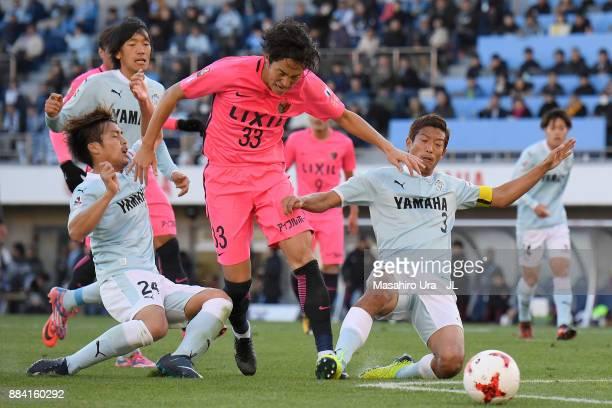 Mu Kanazaki of Kashima Antlers controls the ball under pressure of Daiki Ogawa and Kentaro Oi of Jubilo Iwata during the JLeague J1 match between...