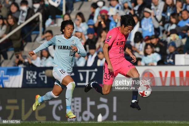 Mu Kanazaki of Kashima Antlers controls the ball under pressure of Shunsuke Nakamura of Jubilo Iwata during the JLeague J1 match between Jubilo Iwata...