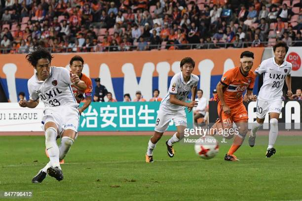 Mu Kanazaki of Kashima Antlers converts the penalty to score his side's fourth goal during the JLeague J1 match between Albirex Niigata and Kashima...