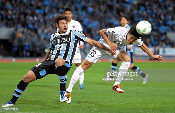 Mu Kanazaki of Kashima Antlers heads to score his team's first goal during the J.League Championship Semi-Final match between Kawasaki Frontale and...
