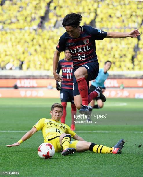 Mu Kanazaki of Kashima Antlers is tackled by Ryuta Koike of Kashiwa Reysol during the JLeague J1 match between Kashima Antlers and Kashiwa Reysol at...