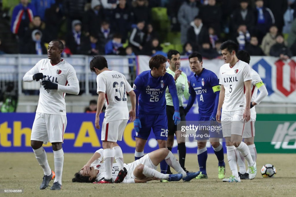 Mu Kanazaki of Kashima Antlers lies injured during the AFC Champions League Group H match between Suwon Samsung Bluewings and Kashima Antlers at Suwon World Cup Stadium on February 21, 2018 in Suwon, South Korea.