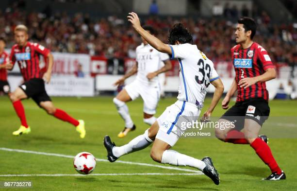 Mu Kanazaki of Kashima Antlers scores his side's second goal during the second half of a JLeague game against Hokkaido Consadole Sapporo at Sapporo...