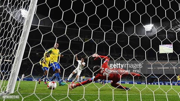 Mu Kanazaki of Kashima Antlers scores his team's second goal past Denis Onyango of Mamelodi Sundowns during the FIFA Club World Cup second round...