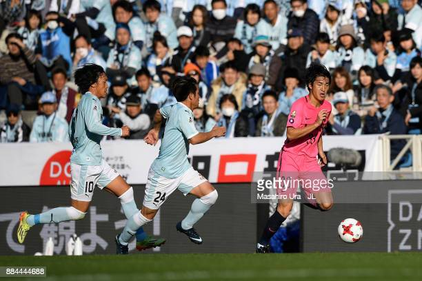 Mu Kanazaki of Kashima Antlers takes on Daiki Ogawa and Shunsuke Nakamura of Jubilo Iwata during the JLeague J1 match between Jubilo Iwata and...