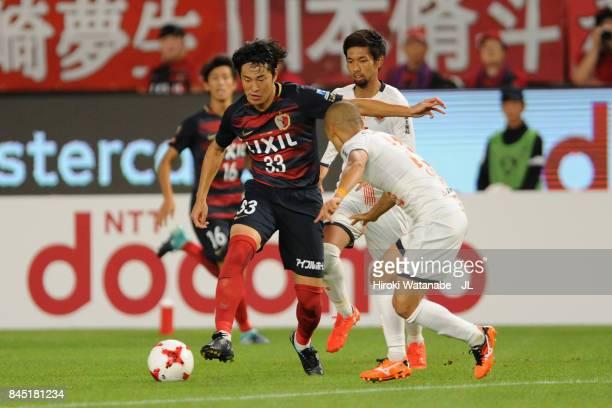 Mu Kanazaki of Kashima Antlers takes on Ryo Okui of Omiya Ardija during the J.League J1 match between Kashima Antlers and Omiya Ardija at Kashima...