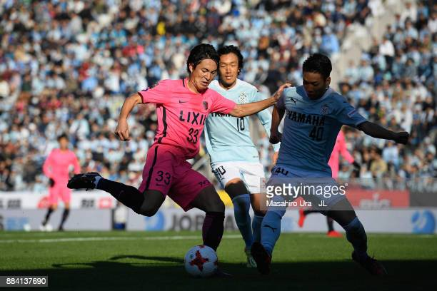 Mu Kanazaki of Kashima Antlers takes on Shunsuke Nakamura and Hayao Kawabe of Jubilo Iwata during the JLeague J1 match between Jubilo Iwata and...