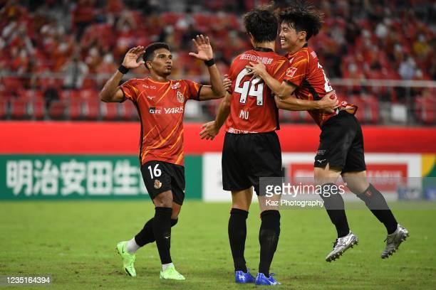 Mu Kanazaki of Nagoya Grampus celebrates 3rd goal for Nagoya Grampus with Shumpei Naruse and Mateus of Nagoya Grampus during the J.League Meiji...